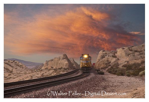 Train rolling through Mojave Desert